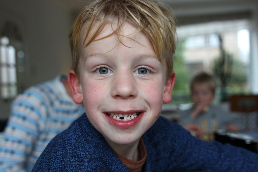 52-49 - lost his first tooth + cycling through the rain